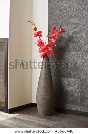 Pink orchid flowers in wicker withe vase - stock photo