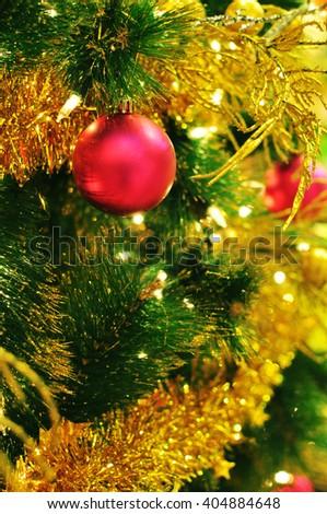 Pink Ornament ball hanging on Christmas tree with bokeh lighting - stock photo