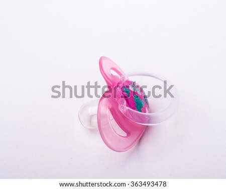 Pink pacifier isolated on white