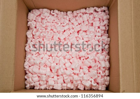 pink packing foam in paper boxes - stock photo