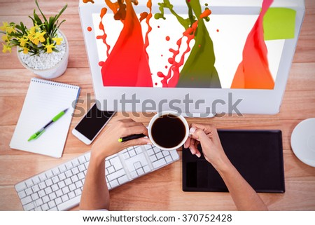 Pink paint splashes and drops against part of hand using stylus - stock photo