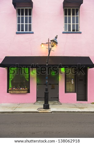 Pink painted architecture in the French Quarter - stock photo
