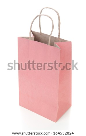 Pink Paper bag isolated on white background .