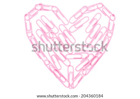 pink paper clips arranged in heart shape on isolated white background. - stock photo