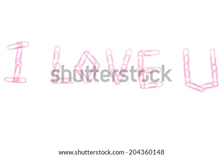 pink paper clips arranged in word i love you on isolated white background. - stock photo
