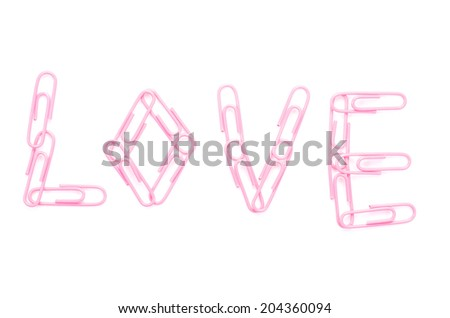 pink paper clips arranged in word love on isolated white background. - stock photo