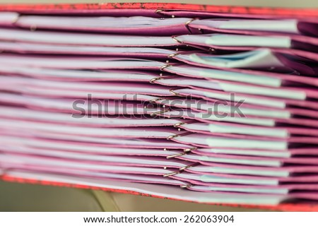 Pink paper file and clips - stock photo