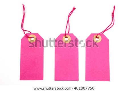 Pink Paper Tags Tied with String. - stock photo
