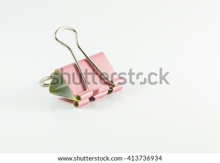 pink paperclip isolated on white background.copy space - stock photo