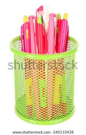 Pink pens in green metal vase isolated on white background - stock photo