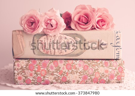 Pink peonies and books  - stock photo