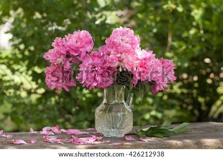 Pink peonies bouquet in vase outdoor