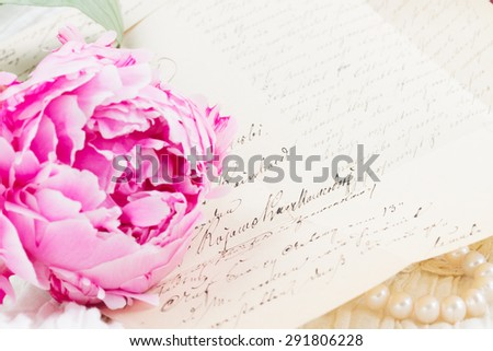 Pink peony flower  with antique handwritten  letter   - stock photo