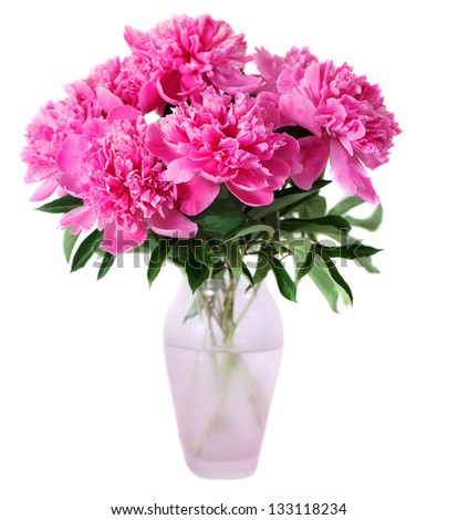 Pink peony flowers in vase isolated on white - stock photo
