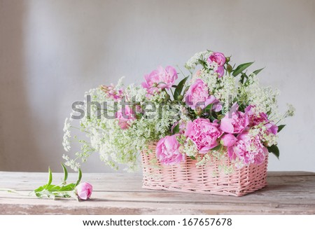 pink peony in basket - stock photo