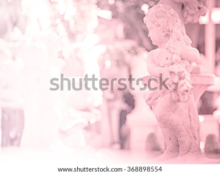pink photo effect of cupid statue background for valentine - stock photo