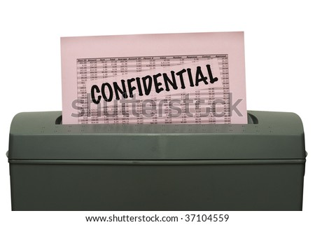 Pink piece of paper with the word confidential and random numbers is getting fed into a shredder. Saved including clipping path.