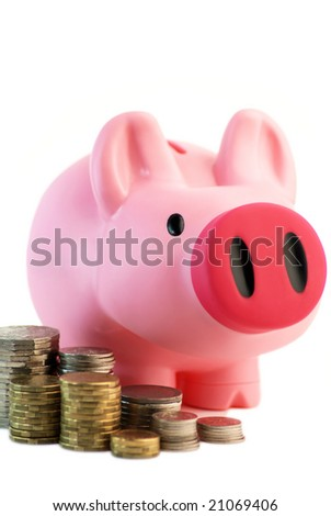 Pink Pig money box/piggy bank with coins - stock photo