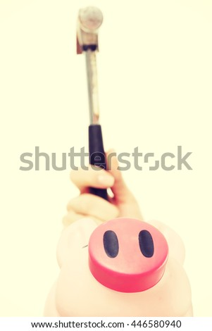 Pink piggy bak and a hammer above it. - stock photo