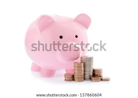 Pink piggy bank and Stacks of money coins isolated over the white background - stock photo