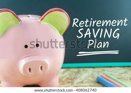 pink piggy bank and word retirement saving plan on blackboard - stock photo