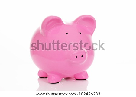 Pink piggy bank, isolated on white in studio