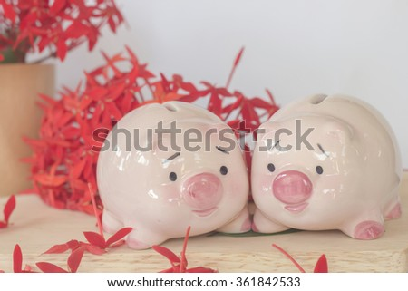 pink piggy bank lover with gift box of flower