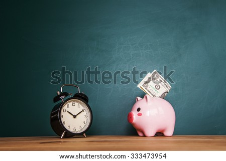 Pink piggy bank on a green background