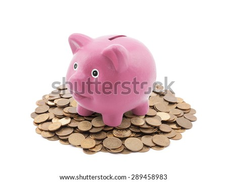 Pink piggy bank on a pile of coins