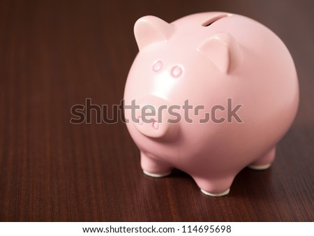 Pink Piggy Bank On Brown Background