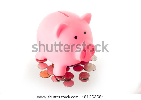 Pink piggy bank on coins of Thailand