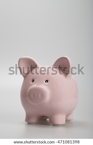pink piggy bank on white background with copy space