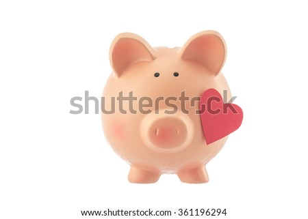 Pink piggy bank toy with heart studio isolated