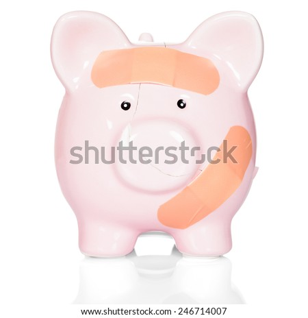 Pink Piggy Bank With Band Aid Over White Background