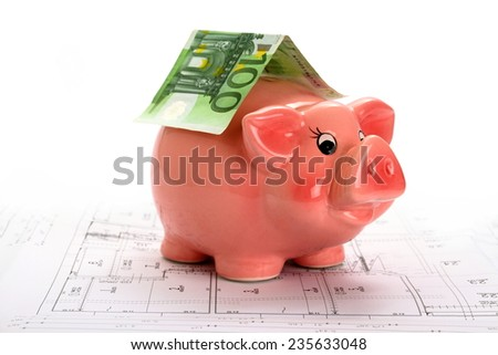 Pink piggy bank with euro banknote on house drawing, white top background - stock photo