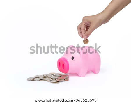 Pink Piggy bank with hand on white background