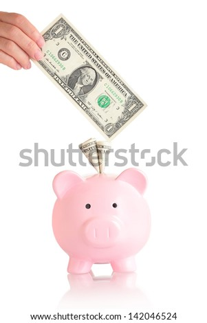 pink piggy bank  with money ( usa one Dollar banknotes ) - stock photo