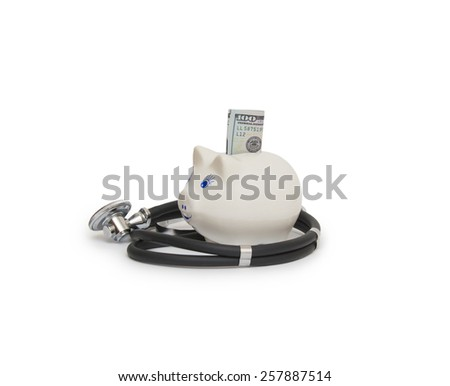Pink piggy bank with stethoscope - stock photo
