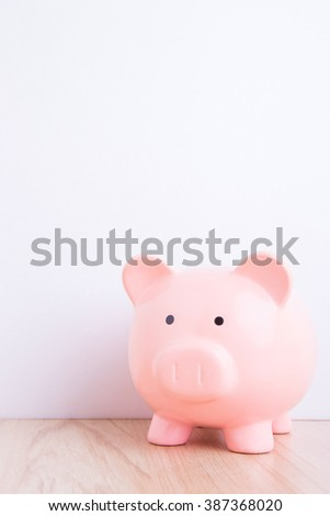 pink piggy bank with white wall background, great for your design