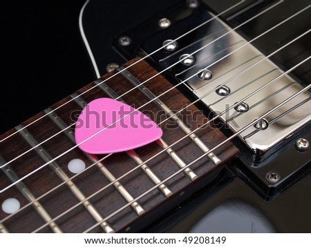 pink pik and vintage jazz guitar - stock photo