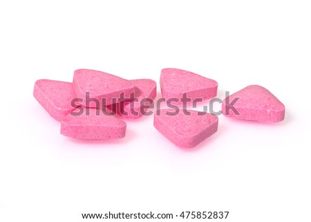 Pink pills triangle shape close up macro photography drug on  white background