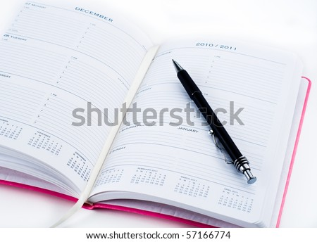 Pink Planner Opened on Page of Changing Years - stock photo