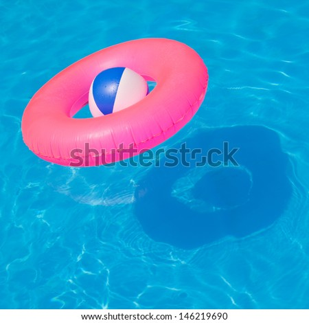 Pink pool float, pool ring in cool blue refreshing blue pool