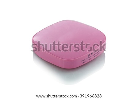 Pink Portable power bank for charging mobile devices - stock photo