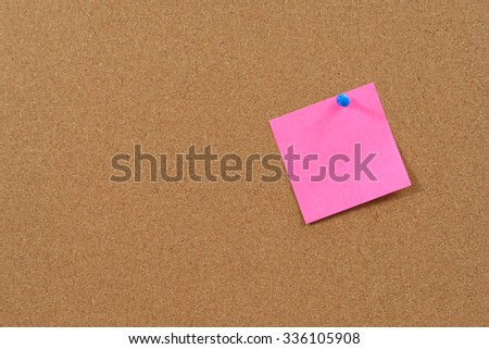 Pink post it notes on cork bulletin board.