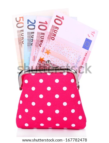 Pink purse with money isolated on white - stock photo