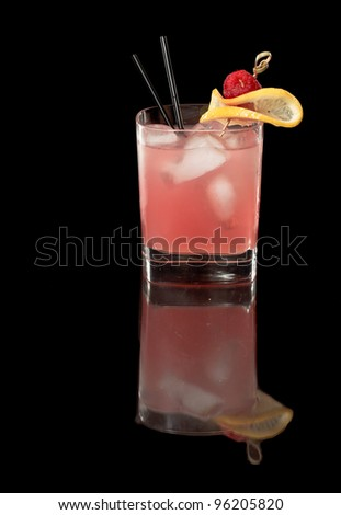 pink raspberry lemonade isolated on a black background garnished with lemon and red raspberry with full reflection