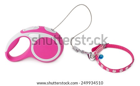 Pink retractable leash for dog and jeweled collar with blue bell isolated on white background - stock photo