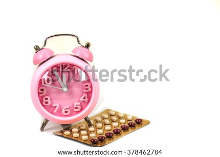 pink retro clock with birth control pill  isolated on white,time for birth control or abortion  concept. - stock photo