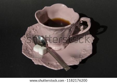 stock-photo-pink-retro-coffee-cup-on-bla